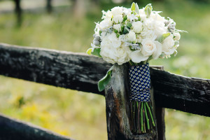 The bride's bouquet was wrapped with one of her father's neckties.