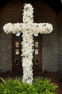 This floral-covered cross shook over 7' tall.