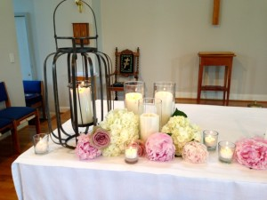 a beautiful altar of fresh flowers, this bride loved peonies