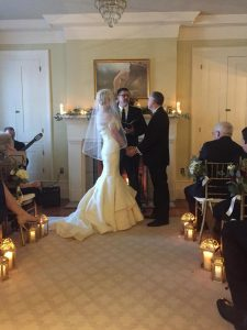 intimate wedding in front of a winter fireplace.  it was snowy outside, but warm inside with all these hearts aglow.