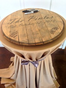 The bourbon barrel head for guests to sign during cocktail hour.