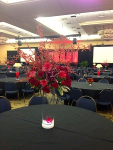 The tall centerpieces added great definition to the large room. The view from the back of the room with the light under the tall vase.